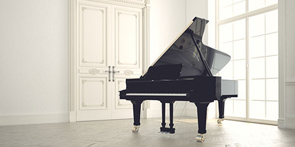 a grand piano in a bare room