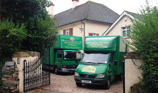 2 sawyerr peters removal vans outside a home